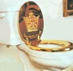 A golden lid on porcelain throne. This toilet is used as a symbolic representation of the madness of kings in this poem